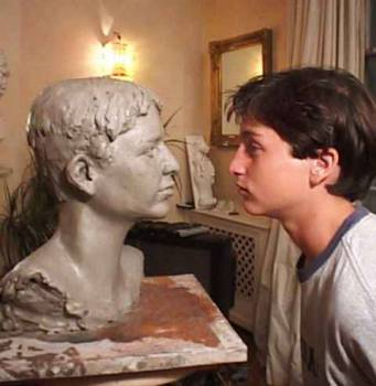 A young client face to face with his bust