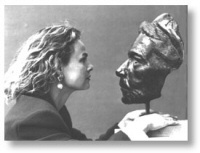 "The artist and her award-winning ""Face"" sculpture"