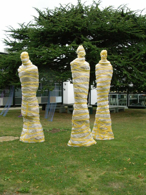 The wrapped monumental statues out on the lawn at UCCA Canterbury campus